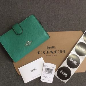 NWT Coach green wallet with coin slot